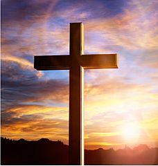 Nuestra fe. Imagen de una cruz con el sol de fondo.